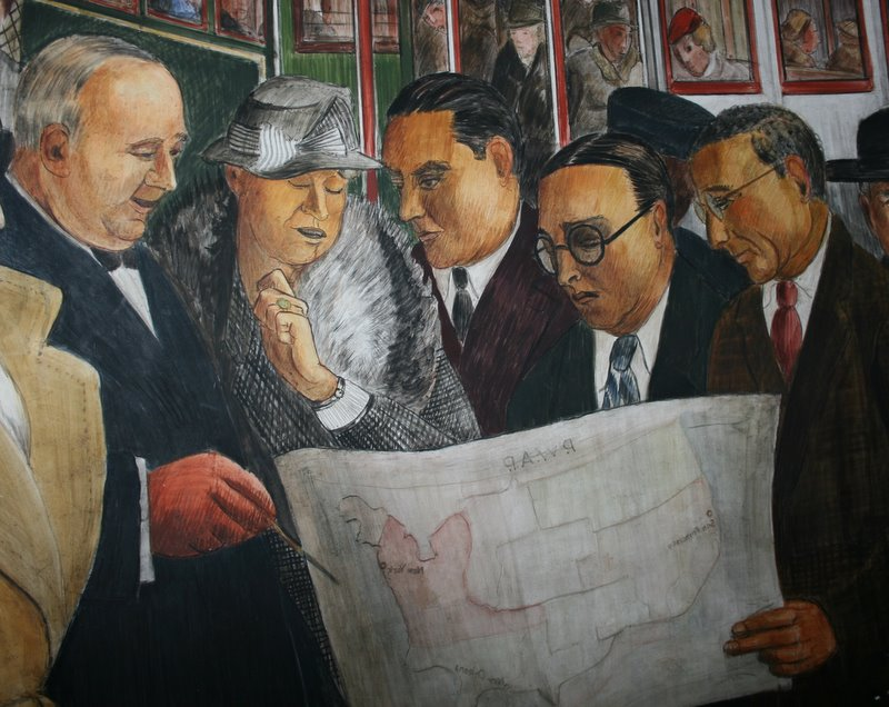Eleanor Roosevelt and other New Dealers examine a map of PWAP projects around the country.